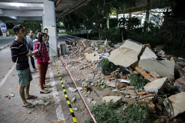 Parts of a shopping mall building collapsed after an earthquake hit in Denpasar, Bali, Indonesia, on Sunday. Photo by Made Nagi/EPA-EFE