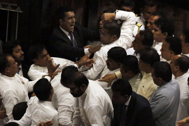 Government and opposition members confront each other during the parliamentary session in Colombo, Sri Lanka, Thursday. Photo by M.A.Pushpa Kumara/ EPA-EFE