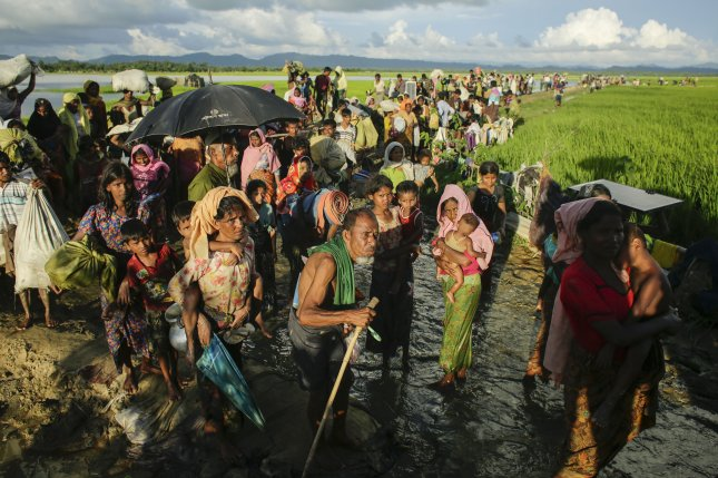 Hundreds of Muslim Rohingya enter Bangladesh from Budichong, Myanmar, on October 9, 2017. The refugees said they left to escape rising violence against Rohingya in their native country. File Photo by Abir Abdullah/EPA-EFE