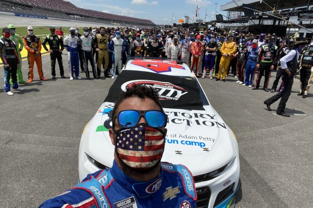 NASCAR's Bubba Wallace said he won the 2020 Geico 500 despite a 14th place finish after he was supported by fellow Cup Series drivers in a pre-race sequence Monday in Lincoln, Ala. Photo courtesy of Bubba Wallace/Twitter