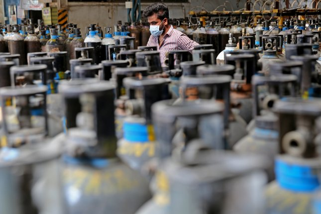 Empty oxygen cylinders are returned from hospitals at oxygen filling center in Bangalore, India, on Wednesday. Photo by Jagadeesh NV/EPA-EFE