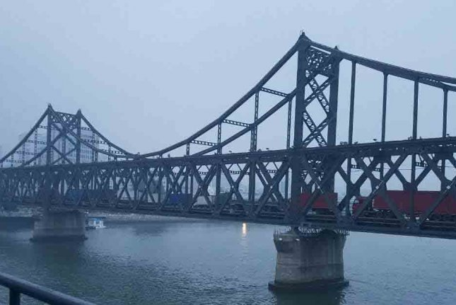 The Sino-Korean Friendship Bridge that spans the Yalu River might be closed as part of sanctions, according to sources. Photo by Yonhap News Service/UPI