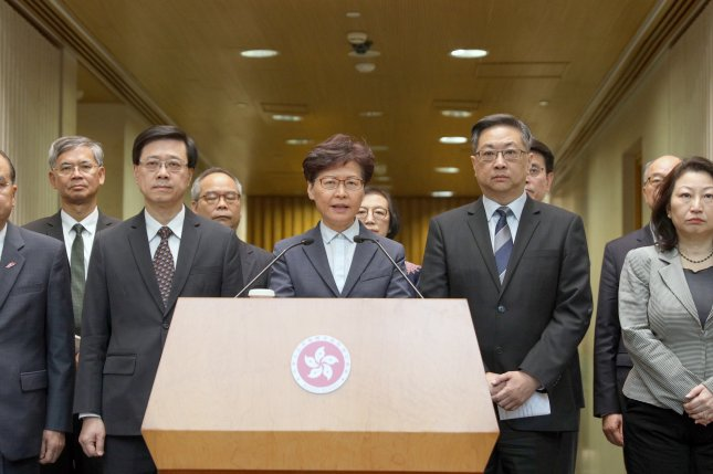 Hong Kong Chief Executive Carrie Lam (C) condemned the violence. Photo by Jerome Favre/EPA-EFE