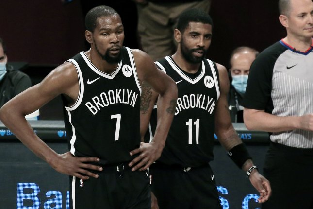 Brooklyn Nets forward Kevin Durant (7) and guard Kyrie Irving (11) got off to hot starts offensively to lead their team to a lopsided win over the Golden State Warriors on Tuesday in Brooklyn, N.Y. Photo by Peter Foley/EPA-EFE