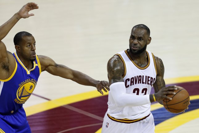 Cleveland Cavaliers forward LeBron James (R) and Golden State Warriors forward Andre Iguodala (L) in action in the first half of Game 3 of the NBA Finals Wednesday at Quicken Loans Arena in Cleveland, Ohio. Photo by David Maxwell/EPA