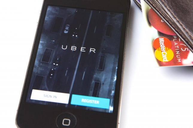 A French man's lawsuit against Uber alleges a glitch in the ride-sharing app revealed his infidelity to his wife, who then divorced him. Photo by Mahathir Mohd Yasin/Shutterstock