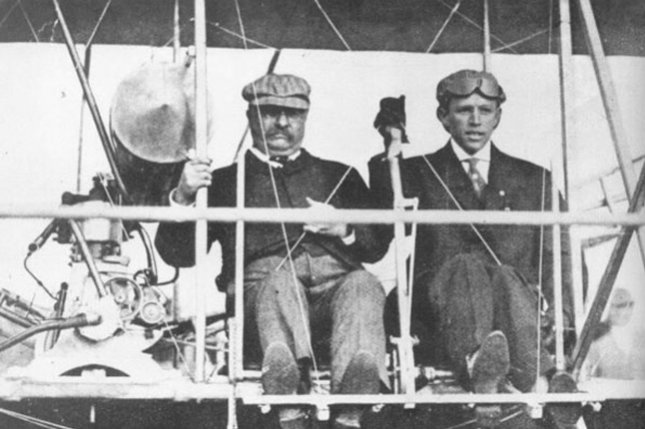 In this October 11, 1910, file photo Col. Theodore Roosevelt takes off from Aviation Field in St. Louis with pilot Arch Hoxsey. Roosevelt described the trip as, the bulliest experience I ever had. UPI File Photo