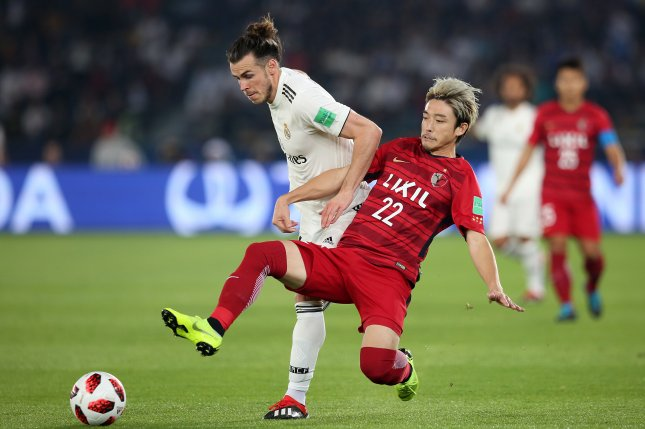 64d504aa9 Gareth Bale (L) of Real Madrid in action against Daigo Nishi (R) of Kashima  Antlers during the FIFA Club World Cup 2018 semifinal match between Real  Madrid ...