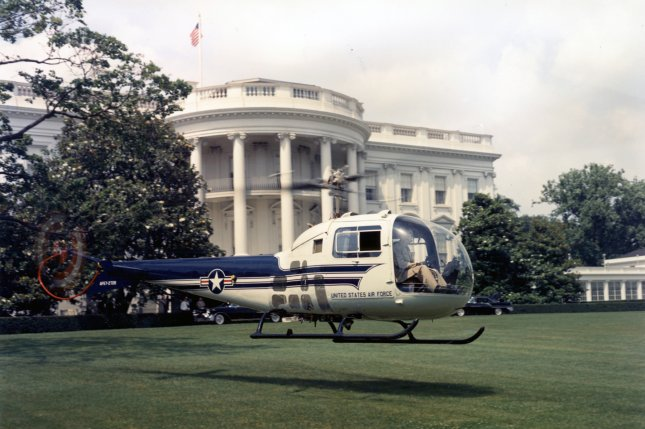In this June 14, 1957, file photo, the UH-13 Bell Ranger presidential helicopter undergoes a series of practice landings on the White House lawn to familiarize Air Force pilots, Maj. Joseph E. Barrett and Capt. Laurence R. Cummings, with the flight path and landing marks. On July 12, President Eisenhower became the first sitting president to fly in a helicopter. Photo courtesy National Museum of the USAF/UPI