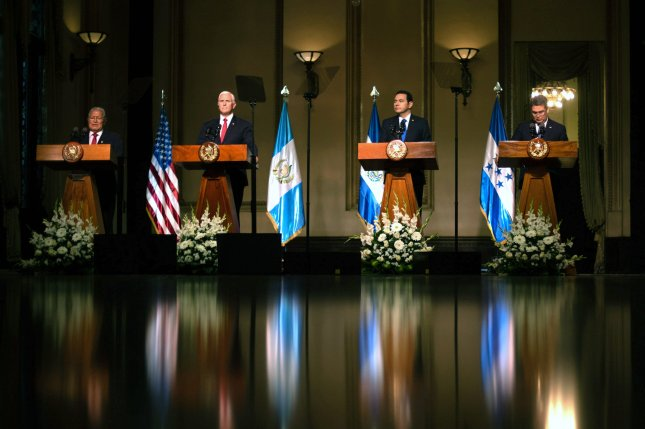 President of Guatemala Jimmy Morales (2-R), President of El Salvador Sanchez Ceren (L), President of Honduras Juan Orlando Hernandez (R) and U.S. Vice President Mike Pence (2L) attend a multilateral conference in Guatemala City, Guatemala, on Thursday. Photo by Billy Santiago/EPA-EFE