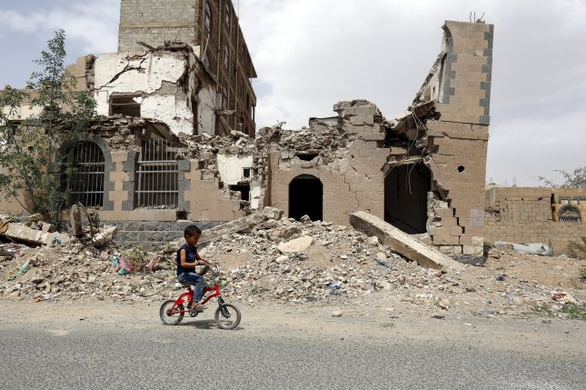 A child rides a bicycle past debris of a destroyed building allegedly hit by a previous Saudi-led airstrike in Yemen. Secretary of State Mike Pompeo declared that the coalition has taken demonstrable efforts to reduce civilian casualties. Yahya Arhab/EPA-EFE