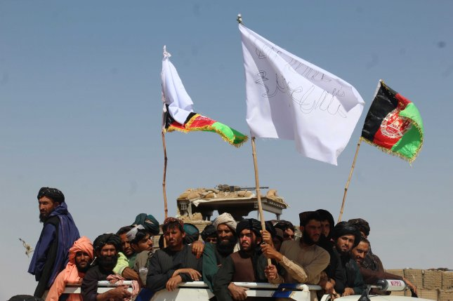 A group of Taliban militants celebrate during a cease-fire in Kandahar, Afghanistan, in 2018. File Photo by Muhammad Sadiq/EPA-EFE