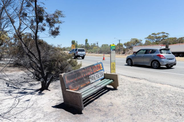 A bus stop damaged by a fire is seen in Kwinana, Australia, on Monday. Western Australian fire authorities issued emergency warnings for out-of-control bushfires across the state. Photo by Richard Wainwright/EPA-EFE