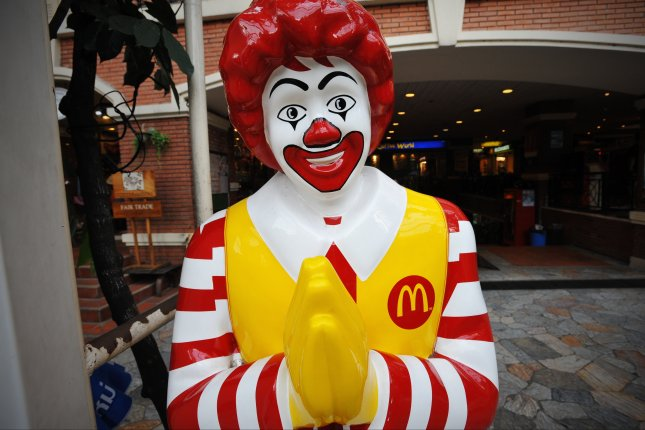 A Ronald McDonald statue in front of a Bangkok, Thailand, McDonald's restaurant. On Nov. 1, 1990, McDonald's, under pressure from environmental groups, announced it would replace plastic food containers with paper. Photo by 1000 Words/Shutterstock