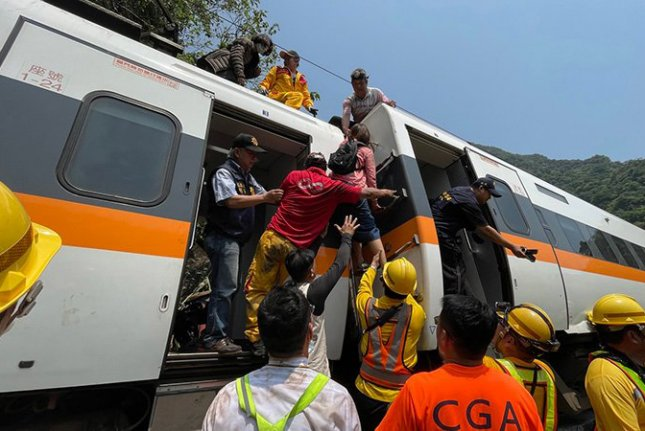 Passengers are rescued from a derailed train in Hualien County, eastern Taiwan, on April 2. File Photo courtesy of Hualien Speedy New/EPA-EFE