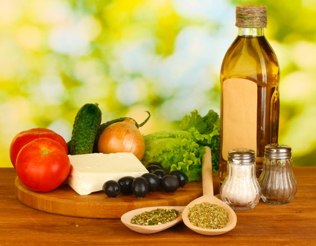 The Mediterranean diet -- marked by high consumption of olive oil, legumes, unrefined cereals, fruits and vegetables, moderate consumption of fish, dairy products and wine and low consumption of non-fish meat -- may prevent age-related macular degeneration. Photo by Africa Studio/Shutterstock