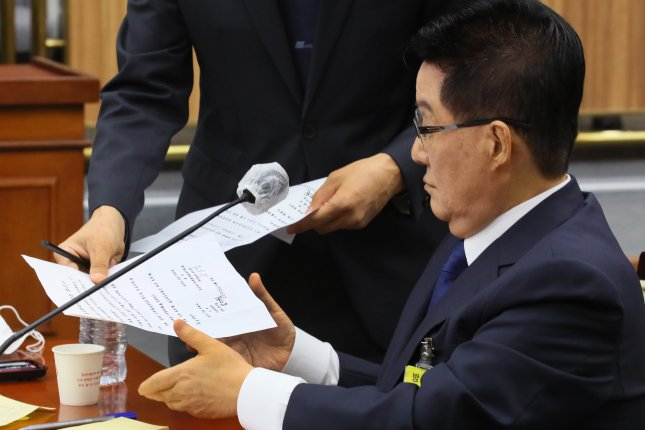 South Korean National Intelligence Service chief nominee Park Jie-won is handed a copy of an alleged secret inter-Korean agreement dating to 2000 on Monday during his confirmation hearing at the National Assembly in Seoul. Photo by Yonhap/EPA-EFE