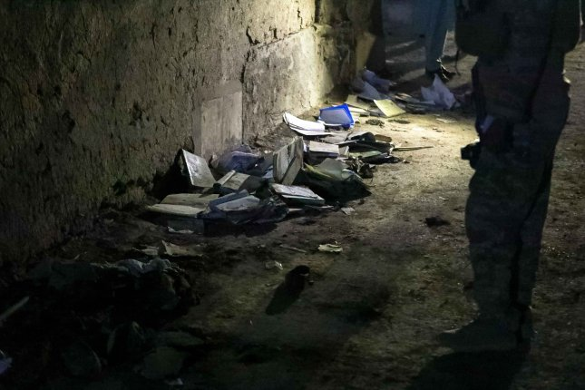 Bloodstained books and notebooks of students are seen on the ground at the scene of a suicide attack at an educational center in Kabul, Afghanistan, on Saturday. Photo by Hedayatullah Amid/EPA-EFE