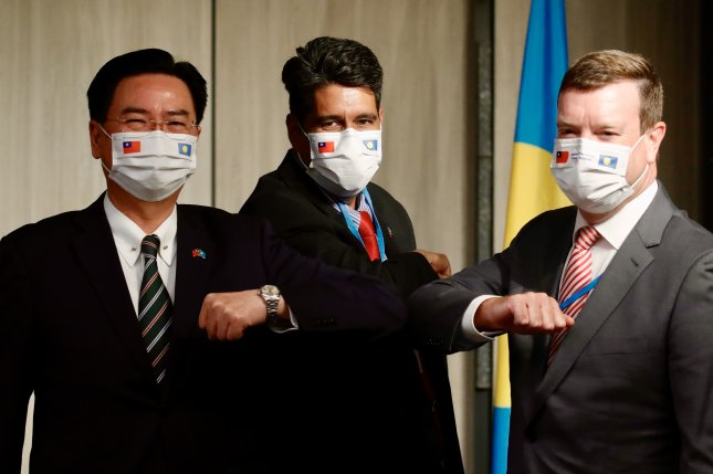 Taiwanese Foreign Minister Joseph Wu (L), Palau President Surangel Whipps Jr. (C) and U.S. Ambassador to Palau John Hennessey-Niland pose at a press conference in Taipei, Taiwan, on Monday. File Photo by Ritchie B. Tongo/EPA-EFE