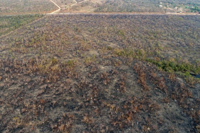 An aerial view of a charred Amazon rain forest in Brazil is seen Tuesday. Officials have said more than 70,000 fires have burned there so far this year. Photo by Rogerio/EPA-EFE