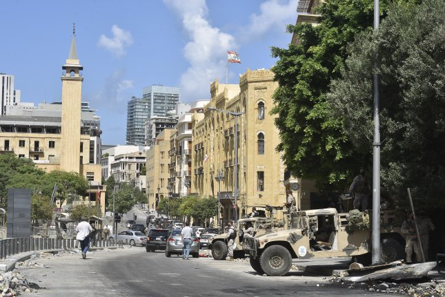Lebanese security forces keep watch after protests Saturday in Beirut, Lebanon. They demanded that all officials responsible for the Beirut explosion should be hanged. Photo by Wael Hamzeh/EPA-EFE