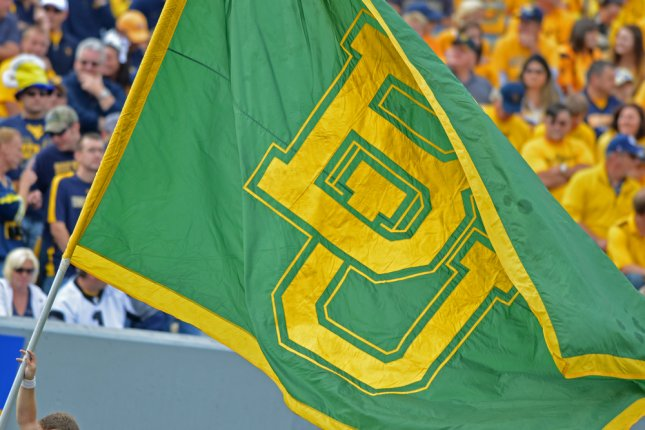 The Baylor University flag is carried on the field after a Baylor Bears touchdown during a Big 12 conference football game on September 29, 2012 in Morgantown, W.Va. Photo by Aspen Photo/Shutterstock