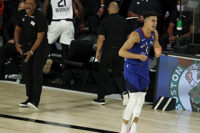 Denver Nuggets forward Michael Porter Jr. (R) reacts after making a shot as Los Angeles Clippers head coach Doc Rivers looks on during the second half of Game 5 in their Western Conference semifinals series Friday at the ESPN Wide World of Sports Complex near Orlando, Fla. Photo by Erik S. Lesser/EPA-EFE