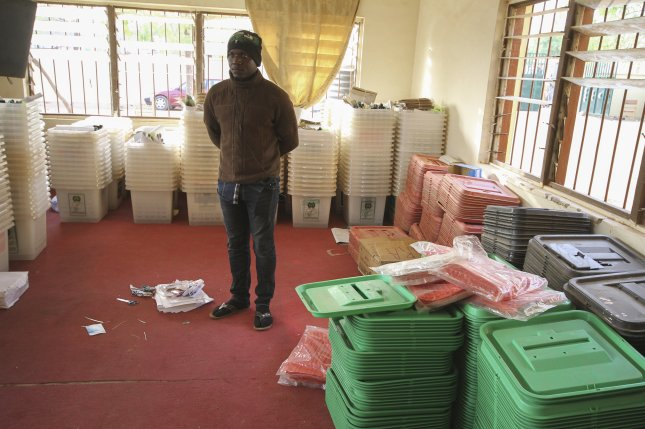 A Nigerian electoral official inspects materials at the Independent National Electoral Commission offices in Daura, Katsina, Nigeria on Saturday. Photo by George Esiri/EPA-EFE