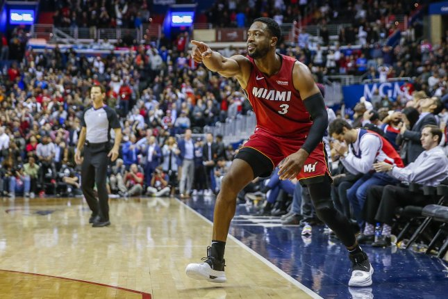 Miami Heat guard Dwyane Wade scored 13 points, including a sensational circus shot in the second quarter of a loss to the Phoenix Suns on Monday in Miami. Photo by Erik S. Lesser/EPA-EFE