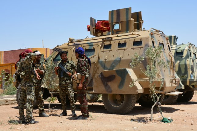 \Members of the Syrian Democratic Forces gather in the village of al-Hazeema north of the city of Raqqa, Syria, on June 6. The U.S.-backed SDF breached through a historic wall surrounding the Old City of Raqqa in its effort to retake the city from the Islamic State. File Photo by Youssef Rabie Youssef/EPA