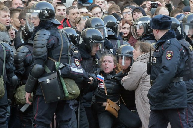 Russian riot policemen detain a demonstrator during an opposition rally in central Moscow on Sunday. According to reports, 100 demonstrators were as they called for the resignation of Russian Prime Minister Dmitry Medvedev over corruption allegations. Photo by Maxim Shipenkov/EPA