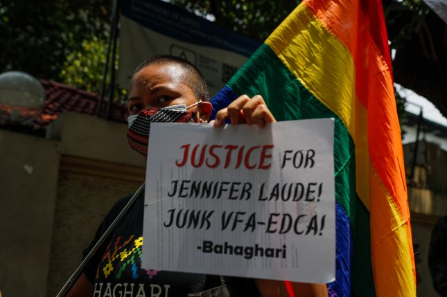 A demonstrator holds a placard during a protest against the early release of U.S. Marine Lance Cpl. Joseph Scott Pemberton for the death of Jennifer Laude at the Department of Justice in Manila, Philippines, on Thursday. Photo Mark R. Cristino/EPA-EFE/