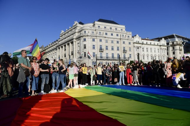 Activists march against a law that bars LGBTQ content from being accessible to children, in front of Hungarian Parliament in Budapest, Hungary, on June 14. File Photo by Szilard Koszticsak/EPA-EFE