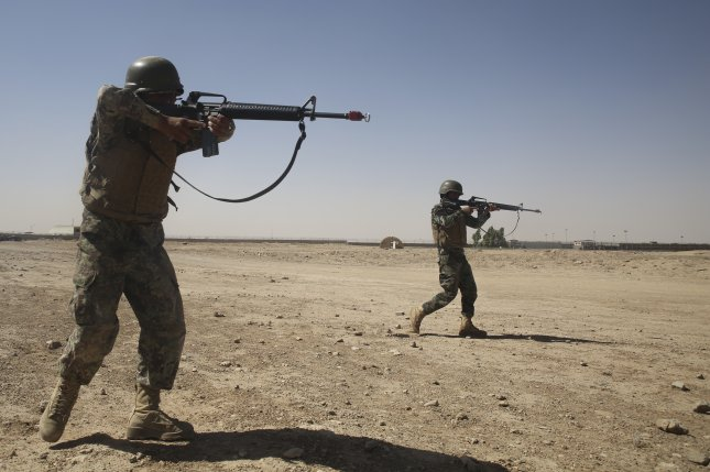 Afghan National Army soldiers with 2nd Kandak, 4th Brigade, 215th Corps close in on a target during a simulated squad attack at Camp Shorabak, Afghanistan on June 12. The Special Inspector General for Afghanistan Reconstruction said U.S. government efforts to stabilize Afghanistan from 2002 and 2017 mostly failed. Photo by Sgt. Lucas Hopkins/U.S. Marine Corps