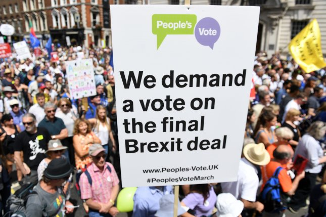 People march through London during a People's March anti-Brexit demonstration in London on Saturday -- the second anniversary of the referendum pass to leave the European Union. Protesters are calling for a referendum on the final deal. Photo by Andy Rain/EPA