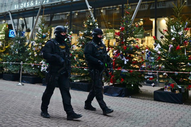 Police officers of the Counter Terrorism Centre with submachine guns patrol at a Christmas market in downtown Budapest, Hungary, on December 20. Security was increased at venues visited by large numbers of people after at least 12 were killed and dozens injured when a truck drove into the Christmas market at Breitscheidplatz in Berlin the day before. File Photo by Janos Marjai/EPA