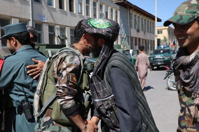 Taliban militants greet Afghan security forces in June 2018 as a group of militants visited the government-controlled areas as a goodwill gesture for peace. File Photo by Jalil Rezayee/EPA-EFE