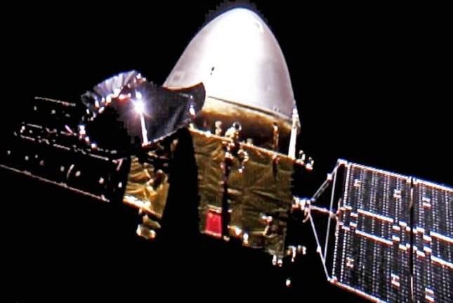 China's Tianwen-1 spacecraft is shown in a photo taken in deep space on the way to Mars in December by a tiny remote camera ejected from the vessel. Photo by China National Space Administration