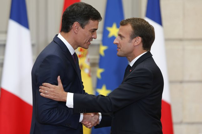 Spanish Prime Minister Pedro Sanchez (L) and French President Emmanuel Macron shake hands during a joint news conference Saturday at the Elysee Palace in Paris. Photo by Thibault Camus/pool/EPA