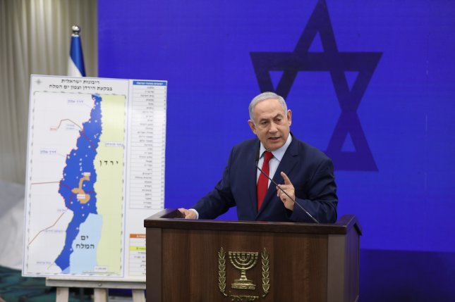 Israeli Prime Minister Benjamin Netanyahu shows a map of the Jordan Valley as he delivers a statement Tuesday in Ramat Gan near Tel Aviv, Israel. Netanyahu stated his aim for Israel to annex the Jordan Valley in coordination with the U.S. administration after the September 17 elections. Photo by Abir Sultan/EPA-EFE