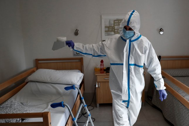 A worker disinfects with ozone one of the rooms of the Casablanca retirement home in the working-class district of Villaverde, Madrid, Spain, on Saturday. Photo by Mariscal/EPA-EFE