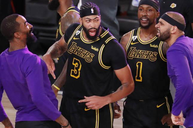 Anthony Davis (3) and the Los Angeles Lakers want to move to 5-0 while wearing Kobe Bryant edition jerseys (pictured) this postseason when they face the Miami Heat in Game 5 of the NBA Finals on Friday in Orlando, Fla. Photo by Erik S. Lesser/EPA-EFE