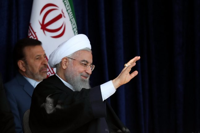 Iranian President Hassan Rouhani speaks to the crowd in the city of Sabzevarr, northwestern Iran, on Sunday. Photo by Iran presidential office/EPA