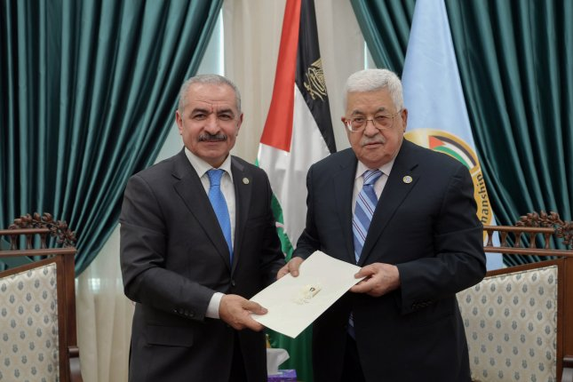 Palestinian President Mahmoud Abbas named senior Fatah official Mohammad Shtayyeh prime minister and ordered him to form a new Palestinian government. Photo by Thaer Ghanaim/EPA