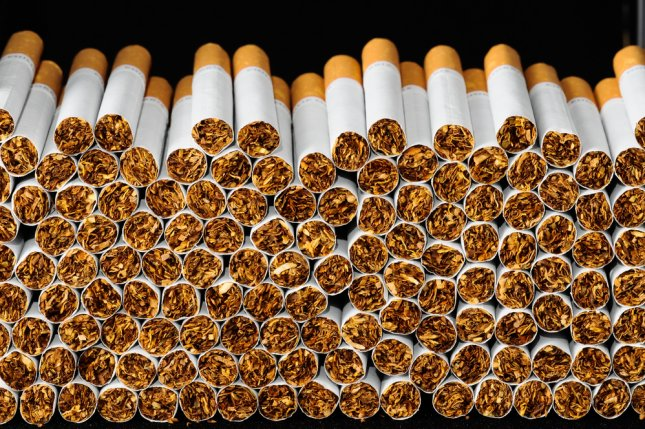 Researchers say that graphic labels on cigarette packaging could have prevented tens of thousands of deaths in the last decade. File Photo by underworld/Shutterstock