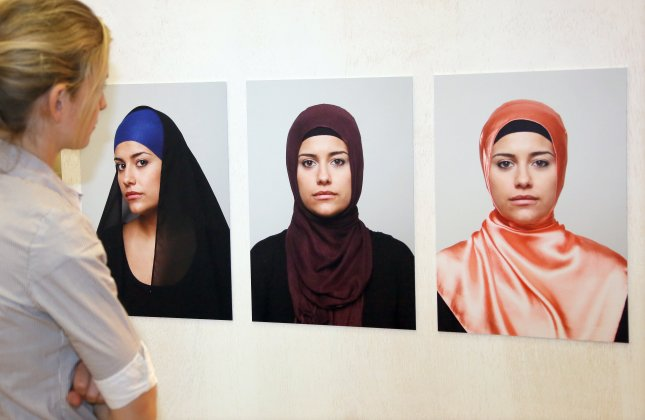 Photographs with different variations of headscarves are on display in the Otto-Hahn-School in Berlin on June 3, 2013. This week, a Berlin court ruled teachers in public schools can't wear headscarves while on duty. File Photo by Stephanie Pilick/EPA