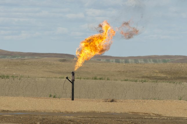 A natural gas well in North Dakota emits, or flares, emissions into the atmosphere as part of the resources drilling process. The Senate voted Wednesday to kill a GOP effort to repeal a new rule that limits the amount of methane gas that can be flared on federal land. File Photo by Steve Oehlenschlager/Shutterstock