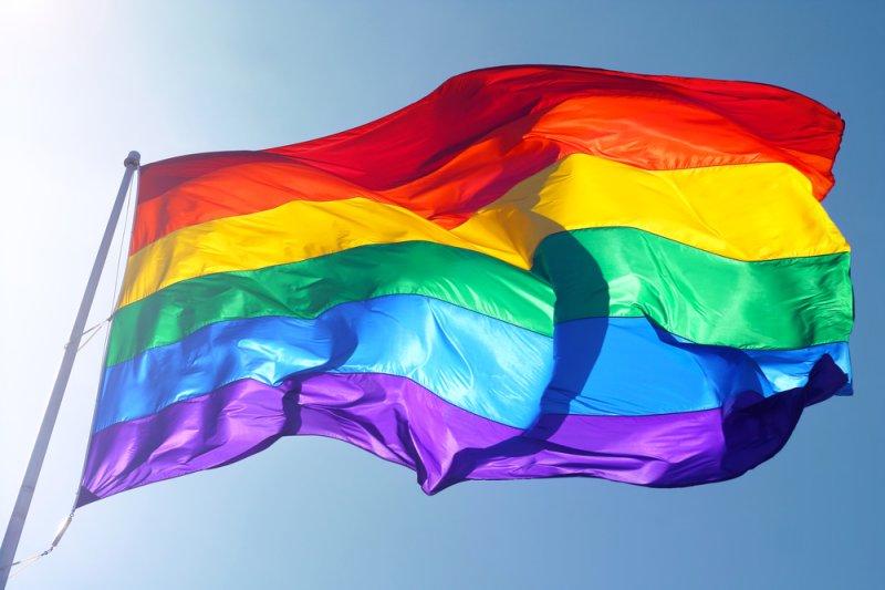 A pride flag waves in the breeze. Natasha Kramskaya/Shutterstock