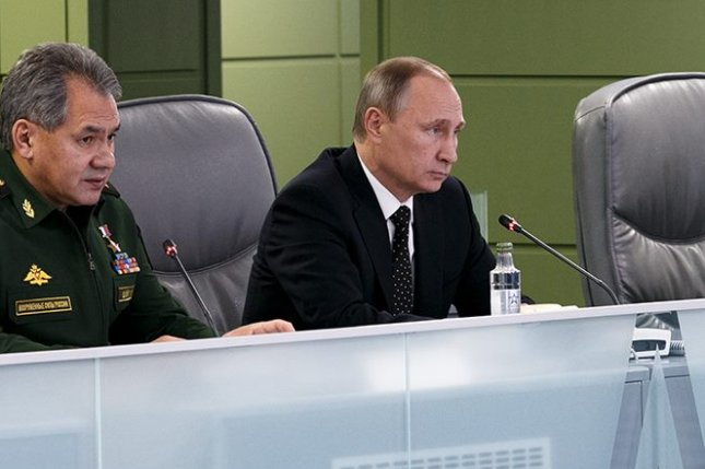 Russian President Vladimir Putin angered after military jet goes down near Turkish border with Syria. Crude oil price spike in response to geopolitical tensions, with major indices up 2 percent from the previous close. Photo courtesy of Russian Ministry of Defense