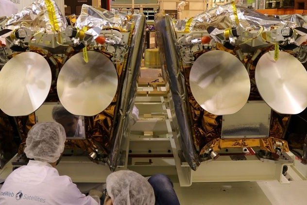 Technicians prepare communications spacecraft for shipment to a launch site at OneWeb Satellites manufacturing plant near Kennedy Space Center in Florida. Photo courtesy of Airbus/OneWeb Satellites